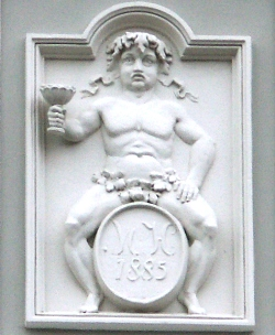 Bacchus - wine god - called 'Fat Maryna', is associated with Torun wine and raftsmen tradition. Fragment of the fasade of 5 Old City Market Square historical house
