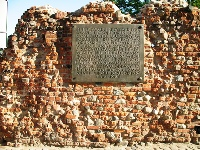 Teutonic castle ruins in Toruń - Northern wall with the commemorative plaque dedicated to the uprising and pulling down the castle in 1454.